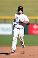 Mesa Solar Sox catcher Sean Ochinko (11) runs the bases after hitting a home run during an Arizona Fall League game against the Surprise Saguaros on October 17, 2014 at Cubs Park in Mesa, Arizona.  Mesa defeated Mesa 5-3.  (Mike Janes/Four Seam Images)