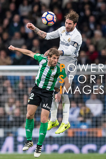 Sergio Ramos of Real Madrid fights for the ball with Darko Brasanac of Real Betis during their La Liga match between Real Madrid and Real Betis at the Santiago Bernabeu Stadium on 12 March 2017 in Madrid, Spain. Photo by Diego Gonzalez Souto / Power Sport Images