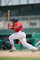 GCL Red Sox catcher Carlos Pulido (23) follows through on a swing during a game against the GCL Orioles on August 9, 2018 at JetBlue Park in Fort Myers, Florida.  GCL Red Sox defeated GCL Orioles 10-4.  (Mike Janes/Four Seam Images)