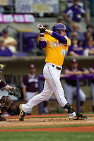 LSU Tigers outfielder Jake Fraley (23) follows through on his swing during the Southeastern Conference baseball game against the Texas A&M Aggies on April 25, 2015 at Alex Box Stadium in Baton Rouge, Louisiana. Texas A&M defeated LSU 6-2. (Andrew Woolley/Four Seam Images)