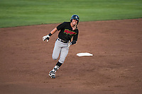 Great Falls Voyagers center fielder Romy Gonzalez (5) rounds second base during a Pioneer League game against the Idaho Falls Chukars at Melaleuca Field on August 18, 2018 in Idaho Falls, Idaho. The Idaho Falls Chukars defeated the Great Falls Voyagers by a score of 6-5. (Zachary Lucy/Four Seam Images)