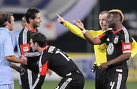 D.C. United defender Brandon McDonald (4) argues with referee Mark Geiger after a hard tackle on forward Chris Pontius (13) Sporting Kansas City defeated D.C. United  1-0 at RFK Stadium, Saturday March 10, 2012.