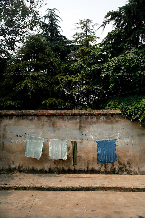 Laundry hangs to dry near a wall in the outskirts of Nanjing, China.