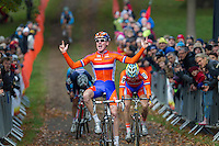 03 NOV 2012 - IPSWICH, GBR - Mike Teunissen (NED) (centre) of the Netherlands celebrates winning the Under 23 Men's European Cyclo-Cross Championships in Chantry Park, Ipswich, Suffolk, Great Britain ahead of team mate Corne van Kessel (NED) (right) and Julian Alaphilippe (FRA) (left) of France (PHOTO (C) 2012 NIGEL FARROW)
