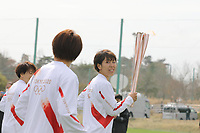 25th March 2021, Fukushima, Japan;  Iwashimizu Azusa and other members of Nadeshiko Japan, the Japan womens National Football Team, run as torchbearers in the first leg of the torch relay for Tokyo Olympic Games