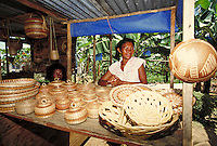 Caribe Indians selling baskets .Caribe Territory, home of the Caribe Indians, island of Dominica , West Indies. Caribe Territory, Dominica West Indies.