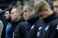 Swansea City manager Steve Cooper and his colleagues observe a minute's silence during the Sky Bet Championship match between Sheffield Wednesday and Swansea City at Hillsborough Stadium, Sheffield, England, UK. Saturday 09 November 2019