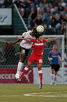 Tina Ellertson of the magicJack and Marta of The Western New York Flash during the second half.  The Western New York Flash defeated the magicJack 3-0 in Women's Professional Soccer (WPS) at Sahlen's Stadium in Rochester, NY May 22, 2011.