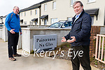Councillors Seamus Cosaí Fitzgerald and Breandan Fitzgerald by the sign at the new estate in Dingle.