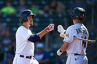 Mesa Solar Sox Bradley Zimmer (7), of the Cleveland Indians organization, fist bumps Brian Anderson (14) after scoring a run during a game against the Scottsdale Scorpions on October 21, 2016 at Sloan Park in Mesa, Arizona.  Mesa defeated Scottsdale 4-3.  (Mike Janes/Four Seam Images)