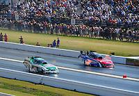 Apr. 29, 2011; Baytown, TX, USA: NHRA funny car drivers John Force (left) and Bob Tasca III during qualifying for the Spring Nationals at Royal Purple Raceway. Mandatory Credit: Mark J. Rebilas-