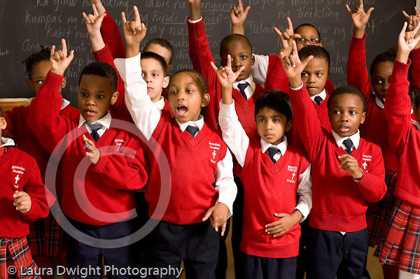 k-8 Parochial School Bronx New York arts enrichment music chorus sign language song with hand gestures horizontal