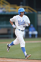 Brian Carroll #24 of the UCLA Bruins runs to first base during a game against the Arizona State Sun Devils at Jackie Robinson Stadium on March 28, 2014 in Los Angeles, California. UCLA defeated Arizona State 7-3. (Larry Goren/Four Seam Images)