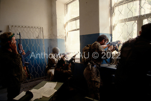 Sukhumi, Abkhazia<br /> September 27, 1993<br /> <br /> From a schoolhouse, Abkhazian separatists attack Georgian forces that are held up inside the Parliament. Within hours the Abkhazians would control the Parliament building and the city.