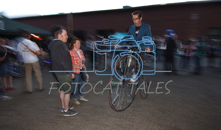 Jason Gardner rides his penny farthing outside the Timbers Saloon during the first annual Blinky Man event in downtown Carson City, Nev., on Wednesday, June 19, 2013.<br /> Photo by Cathleen Allison
