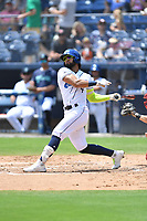 Asheville Tourists Carlos Machado (4) swings at a pitch during a game against the Greenville Drive on July 18, 2021 at McCormick Field in Asheville, NC. (Tony Farlow/Four Seam Images)