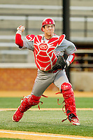 North Carolina State Wolfpack catcher Brett Austin (11) makes a throw to first base against the Wake Forest Demon Deacons at Wake Forest Baseball Park on March 15, 2013 in Winston-Salem, North Carolina.  The Wolfpack defeated the Demon Deacons 12-6.  (Brian Westerholt/Four Seam Images)