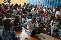 Port au Prince, Haiti, April 20, 2010.A fanatic audience stands around Pierre Widens and his 2 colleagues from Radio TV Ginen as they are commenting live a football match between Barcelona and Inter Milan. Football is by far the most popular sprt in Haiti..