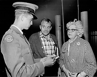 Yanks at Expo - Montreal's World's Fair has just come through its first big invasion by American tourists on Memorial Day weekend who have often been baffled to find French spoken. Typical reactions were those of Mr. and Mrs. Robert Humphreys of Olean; N.Y.; with Expo security guard.<br /> <br /> 1967<br /> <br /> PHOTO :  Dick Darrell - Toronto Star Archives - AQP