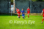 Peter Murphy of Tralee Dynamos clears his defence as Killarney Athletic's Adam Moynihan is about to challenge him, in the Denny Premier A soccer league