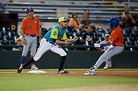 Bradenton Barbanegras third baseman Dylan Busby (28) looks to tag Wagner Lagrange (7) during a Florida State League game against the St. Lucie Mets on July 27, 2019 at LECOM Park in Bradenton, Florida.  Bradenton defeated St. Lucie 3-2.  (Mike Janes/Four Seam Images)