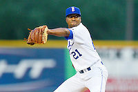Burlington Royals relief pitcher Julio Morales (21) in action against the Danville Braves at Burlington Athletic Park on July 18, 2012 in Burlington, North Carolina.  The Royals defeated the Braves 4-3 in 11 innings.  (Brian Westerholt/Four Seam Images)