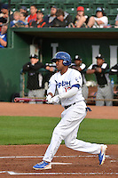 Stefen Henderson (12) of the Ogden Raptors at bat against the Grand Junction Rockies during Opening Night of the Pioneer League Season on June 16, 2014 at Lindquist Field in Ogden, Utah. (Stephen Smith/Four Seam Images)