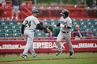 Akron RubberDucks manager Rouglas Odor (24) congratulates Tyler Friis (38) as he rounds the bases after hitting a home run during an Eastern League game against the Erie SeaWolves on June 2, 2019 at UPMC Park in Erie, Pennsylvania.  Akron defeated Erie 7-2 in the first game of a doubleheader.  (Mike Janes/Four Seam Images)