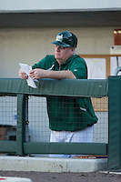 Charlotte 49ers head coach Loren Hibbs (49) checks his notes during the game against the North Carolina State Wolfpack at BB&T Ballpark on March 31, 2015 in Charlotte, North Carolina.  The Wolfpack defeated the 49ers 10-6.  (Brian Westerholt/Four Seam Images)