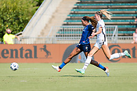CARY, NC - SEPTEMBER 12: Jessica McDonald #14 of the NC Courage takes a shot while pressured by Kelli Hubly #20 of the Portland Thorns during a game between Portland Thorns FC and North Carolina Courage at WakeMed Soccer Park on September 12, 2021 in Cary, North Carolina.