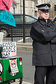 Policeman on duty at a People & Planet protest on April Fools' Day outside Parliament against proposals to build a coal-fired power station in Kingsnorth, Kent.