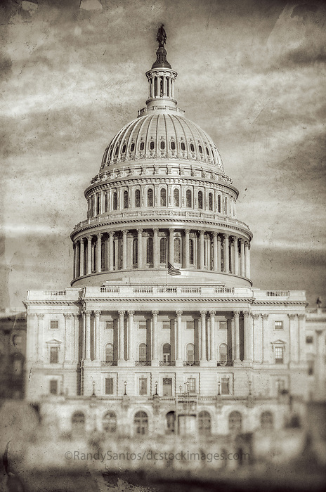 US Capitol Building Washington DC - Washington DC Stock Photography<br /> The United States Capitol Building is located on Capitol Hill at the east end of the National Mall in Washington DC.  The US Capitol is among the most symbollically important and architecturally impressive buildings in the United States. It has housed the meeting chambers of the US House of Representatives and US Senate for two centuries.  An example of 19 century neo-claccical architecture.  Architectural details include columns, porticos, arches, steps, the US Capitol dome and rotunda.  A washington D.C. landmark and national icon it is a popular tourist attraction and travel destination in Washington DC.<br /> <br /> All images on this site copyright Randy Santos 2007 - 2010<br /> No unauthorized use of any image without written permission<br /> <br /> http://www.dcstockphotos.com<br /> http://www.dcstockimages.com<br /> <br /> All images are very high quality image files available for license in various media.  Please contact for license or visit:<br /> <br /> http://www.dcstockphotos.com<br /> http://www.randysantosphoto.com<br /> http://www.randysantos.blogspot.com Black and White Photography Washington DC Art - - Framed Prints - Wall Murals - Metal Prints - Aluminum Prints - Canvas Prints - Fine Art Prints Washington DC Landmarks Monuments Architecture