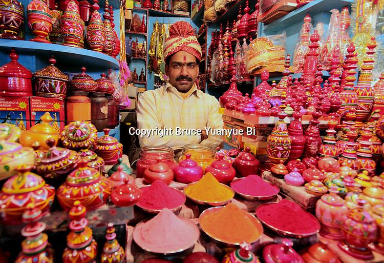 shopkeep with his goods in Varanasi old town. Varanasi. India