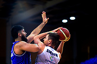 Tohi Smith-Milner tries to block Nicholas Barrow during the National Basketball League Final Four semifinal match between Wellington Saints and Auckland Huskies at Te Rauparaha Arena in Porirua, New Zealand on Thursday, 22 July 2021. Photo: Dave Lintott / lintottphoto.co.nz