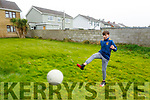 Ciarán O'Connell, a member of the Ballymacelligott GAA club who are encouraging young players to practice and perfect their skills at home -  all you need is a ball and a wall.