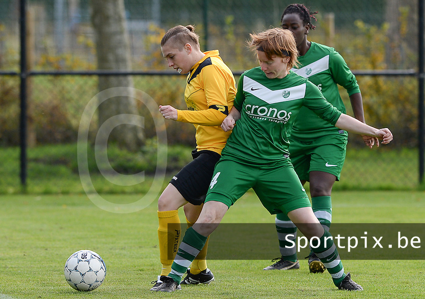 20151024 - ZWEVEZELE , BELGIUM : Joyce Vaernewyck (l) pictured with Emily Van Loon (r)  during a soccer match between the women teams of SKV Zwevezele Ladies and KSOC Maria Ter Heide  , during the eight matchday in the Third League - Derde Nationale season, Saturday 24 October 2015 . PHOTO DAVID CATRY