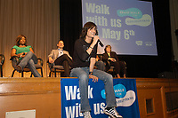 Recording artist David Usher speaks to Jarvis Collegiate Institute students in Toronto about why he's participating in this year's Bell Walk for Kids Help Phone, taking place on Sunday, May 6, while singer Jully Black, Kevin Crull of Bell Canada and Donna Hansplant of Kids Help Phone look on. (CNW Group/Kids Help Phone)