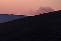 10/05/16 <br /> <br /> A game keeper is silhouetted on the horizon as he makes his way to put out another fire after sun-down last night.  <br /> <br /> Full story:   http://www.fstoppress.com/articles/peak-district-fire/<br /> <br /> .A small group of gamekeepers spent the night fighting a major blaze blaze covering two hundred acres of heather moorland close to the Derwent and Ladybower reservoirs in the Derbyshire Peak District.<br /> <br /> The fire, which broke out at around 1pm on Monday, is believed to have been started by a disposable barbecue, according to a spokesman for the reservoir, which quickly escalated into a major fire threatening the natural habitat of many wild animals and birds including red grouse, plovers, meadow pipits and hen harriers.<br /> <br /> Ten fire crews were called to tackle the flames, and remained on scene until dusk fell, leaving the job of managing the fire overnight to the gamekeepers on scene.<br /> <br /> Kieran Logan was one of the gamekeepers left battling the flames and he said moorland management policies implemented some 10 years ago by the landowners, The National Trust were also partly to blame.<br /> <br /> All Rights Reserved: F Stop Press Ltd. +44(0)1335 418365   +44 (0)7765 242650 www.fstoppress.com