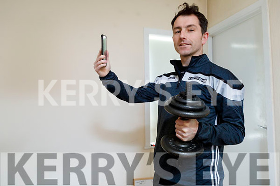 Conor O Neill preparing to go live with his workout video at his home in Listowel on Friday.
