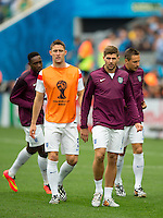 Steven Gerrard of England with team mates Gary Cahill and Phil Jagielka