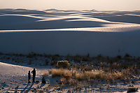 People stand near a backcountry camping site among the dunes at White Sands National Monument near Alamogordo, New Mexico, USA, on Sat., Dec. 30, 2017.