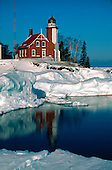 Eagle Harbor lighthouse on Lake Superior in the Keweenaw peninsula of the Upper Peninsula of Michigan in winter.