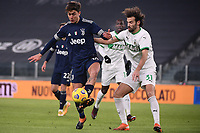 Paulo Dybala of Juventus FC and Gian Marco Ferrari of US Sassuolo compete for the ball during the Serie A football match between Juventus FC and US Sassuolo Calcio at Allianz stadium in Torino (Italy), January 10th, 2021. Photo Federico Tardito / Insidefoto