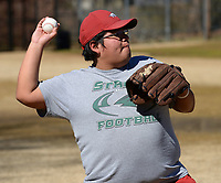 David Carnevale, a senior at the University of Arkansas from Kansas City, Mo., throws a baseball Tuesday, Feb. 23, 2021, while playing catch with a friend at the ball field in Wilson Park in Fayetteville. After a week of wintry weather, temperatures rose into the 70s. Visit nwaonline.com/210224Daily/ for today's photo gallery. <br /> (NWA Democrat-Gazette/Andy Shupe)