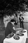 The Wicken Love Feast, takes place on Ascension Day and celebrates the joining together of two parishes in 1587. Feast laid out under the Gospel Elm.  Wicken Northamptonshire 1970s Uk. (Not sure here it may be an Elm)