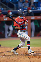 Jose Devers (27) of the Jacksonville Jumbo Shrimp follows through on his swing against the Durham Bulls at Durham Bulls Athletic Park on May 15, 2021 in Durham, North Carolina. (Brian Westerholt/Four Seam Images)