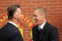 Pictured L-R: Managers Louis Van Gaal of Manchester United and Garry Monk of Swansea City greeting each other before kick off.  Saturday 16 August 2014<br /> Re: Premier League Manchester United v Swansea City FC at the Old Trafford, Manchester, UK.