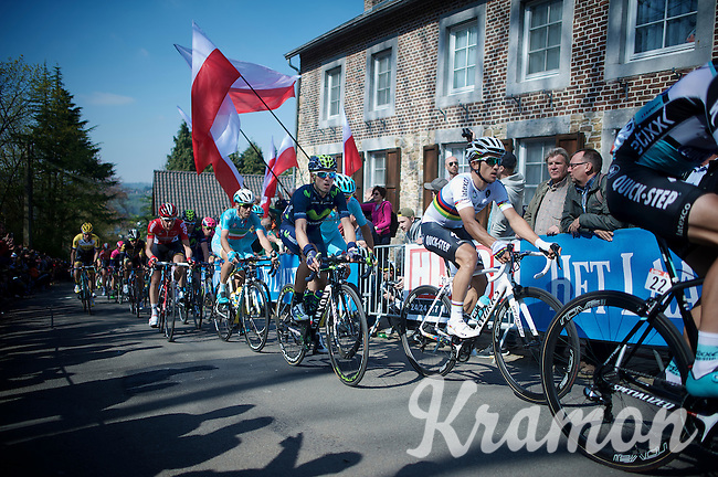 World Champion Michal Kwiatkowski (POL/Ettix-Quickstep) rides up the infamous Mur de Huy (1300m/9.8%) under a fan's salute of polish flags while being closely followed by (later winner) Alejandro Valverde (ESP/Movistar), Vincenzo Nibali (ITA/Astana) & Tim Wellens (BEL/Lotto-Soudal).<br /> <br /> 79th Flèche Wallonne 2015