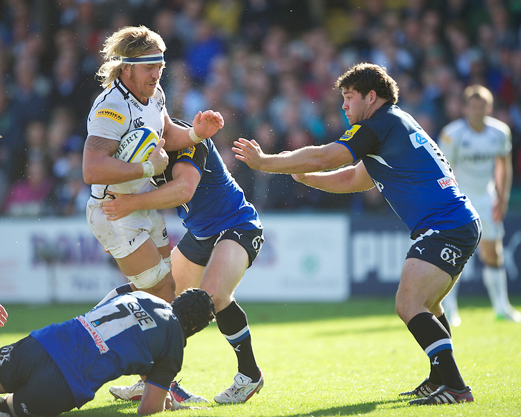 Andy Powell of Sale Sharks is tackled by Ben Skirving of Bath Rugby during the Aviva Premiership match between Bath Rugby and Sale Sharks at the Recreation Ground on Saturday 29th September 2012 (Photo by Rob Munro)