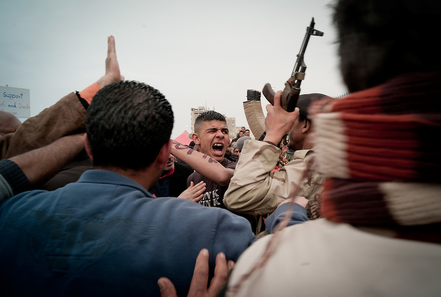 A heated argument outside the courthouse in Benghazi, Libya.
